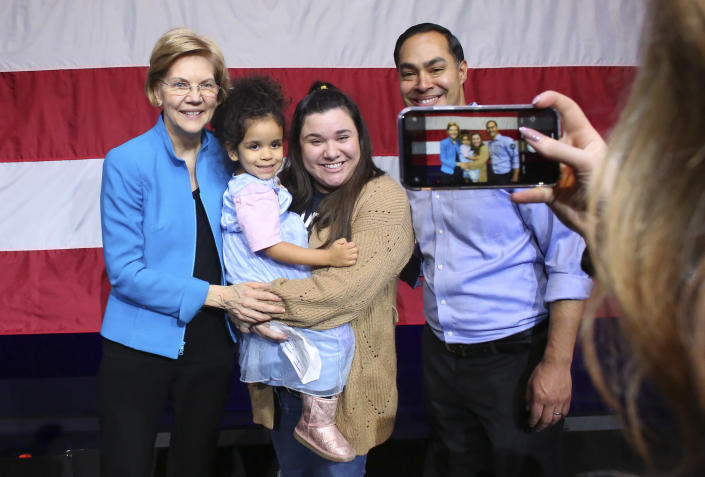 Elizabeth Warren and Julián Castro pose with her followers on Jan. 7. After dropping out of the race, Castro endorsed Warren for president. (Photo: Kena Betancur/Getty Images)