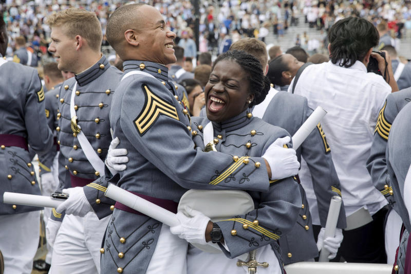 West Point cadets hug each other at the end of graduation ceremonies at the United States Military Academy, Saturday, May 25, 2019, in West Point, N.Y. (AP Photo/Julius Constantine Motal)