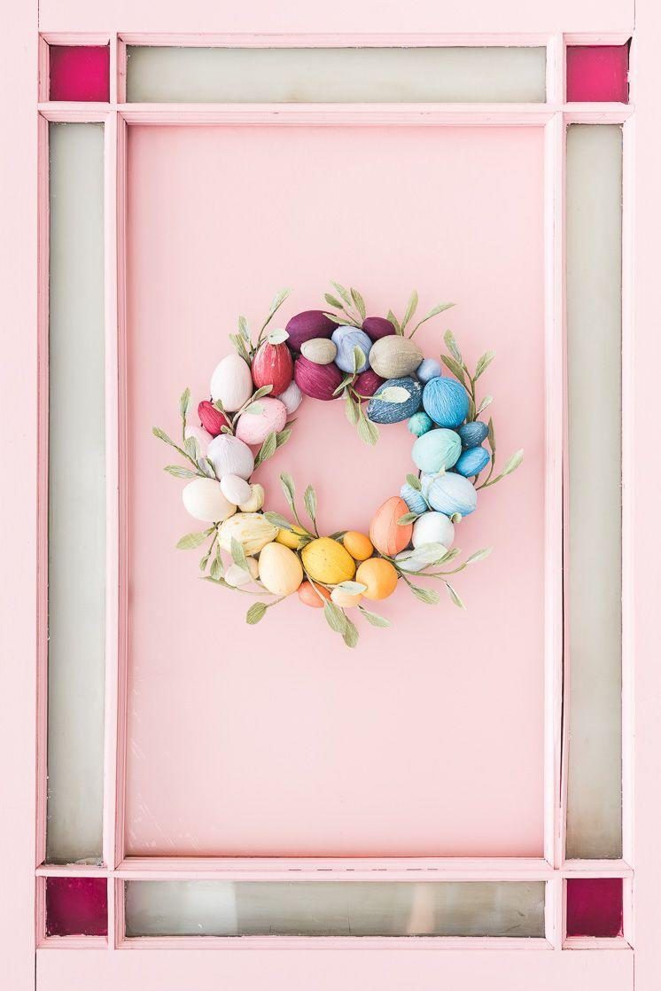 """<p>Skip the mess of Easter egg dyeing by covering plastic eggs with crepe paper to achieve a door-worthy look. </p><p><em><a href=""""http://thehousethatlarsbuilt.com/2018/02/rainbow-easter-egg-wreath.html/?utm_medium=Social&utm_source=Pinterest"""" rel=""""nofollow noopener"""" target=""""_blank"""" data-ylk=""""slk:Get the tutorial at The House that Lars Built »"""" class=""""link rapid-noclick-resp"""">Get the tutorial at The House that Lars Built » <br></a></em></p>"""