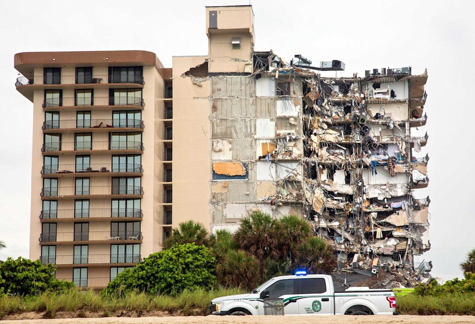 The collapsed Surfside tower is pictured with apartments exposed.