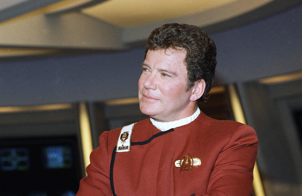 """FILE - In this 1988 file photo, William Shatner, who portrays Capt. James T. Kirk, attends a photo opportunity for the film """"Star Trek V: The Final Frontier."""" Star Trek's Captain Kirk is rocketing into space this month — boldly going where no other sci-fi actors have gone. Jeff Bezos' space travel company, Blue Origin, announced Monday, Oct. 4, 2021 that Shatner will blast off from West Texas on Oct. 12. (AP Photo/Bob Galbraith)"""