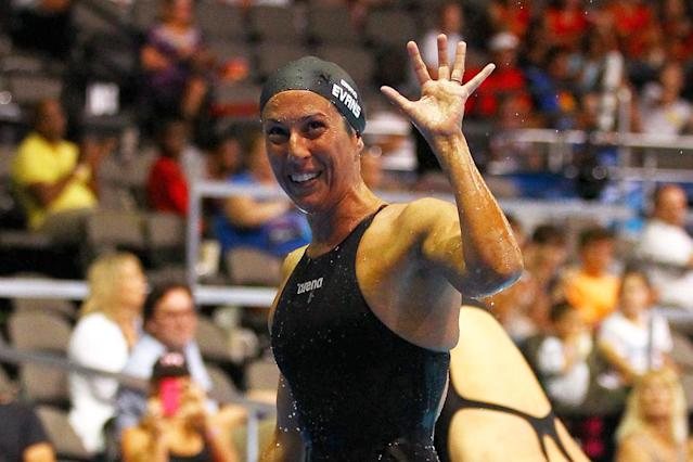 Janet Evans waves towards the stands after she competed in preliminary heat 6 of the Women's 400 m Freestyle during Day Two of the 2012 U.S. Olympic Swimming Team Trials at CenturyLink Center on June 26, 2012 in Omaha, Nebraska. (Al Bello/Getty Images)