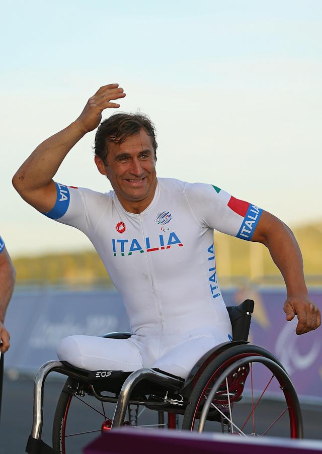 LONGFIELD, ENGLAND - SEPTEMBER 08: Alessandro Zanardi of Italy celebrates winning the Silver Medal in the Mixed H 1-4 Cycling Team Relay on day 10 of the London 2012 Paralympic Games at Brands Hatch on September 8, 2012 in Longfield, England. (Photo by Mike Ehrmann/Getty Images)