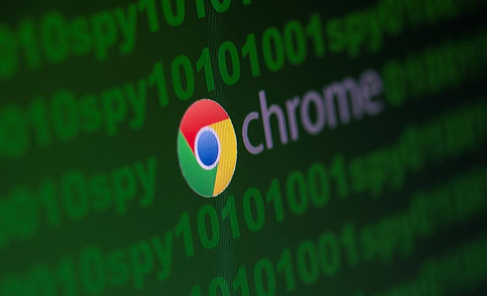 "Google Chrome logo is seen near cyber code and words ""spy""  in this illustration picture taken June 18, 2020. REUTERS/Dado Ruvic/Illustration"