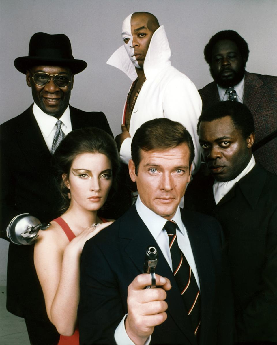 Actors Roger Moore, Yaphet Kotto, Julius W.Harris, Geoffrey Holder, Earl Jolly Brown and actress Jane Seymour, on the set of