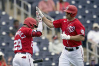 Washington Nationals' Ryan Zimmerman, right, is congratulated by teammate Yadiel Hernandez after hitting a solo home run during the third inning of a spring training baseball game against the Houston Astros Monday, March 1, 2021, in West Palm Beach, Fla. (AP Photo/Jeff Roberson)