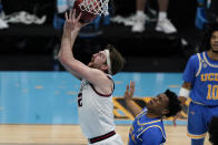 Gonzaga forward Drew Timme, left, shoots ahead of UCLA guard Jaylen Clark, right, during the second half of a men's Final Four NCAA college basketball tournament semifinal game, Saturday, April 3, 2021, at Lucas Oil Stadium in Indianapolis. (AP Photo/Michael Conroy)
