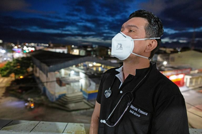 Brazilian doctor Marcos Fonseca Barbosa is caring for his COVID-19 infected mother at home