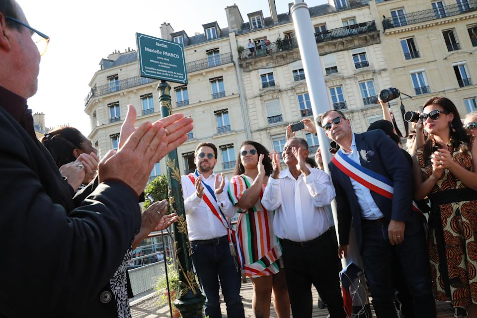 The father of slain Brazilian councilwoman Marielle Franco, Antonio da Silva (3rd L) claps as he stands with other family members and French officials during the inauguration of the ' Jardin Marielle Franco' a public garden close to Gare de lEst train station in northern Paris on September 21, 2019. - Brazilian politician, feminist, and human rights activist Marielle Franco was shot to death on March 14, 2018, by two gun wielding assailants north of Rio de Janeiro in Brazil. Her murder came the day after she spoke out against police violence in Rio. In March 2019, two former members of the Brazilian military police force were arrested and charged with the murder of Marielle Franco. (Photo by JACQUES DEMARTHON / AFP)        (Photo credit should read JACQUES DEMARTHON/AFP via Getty Images)