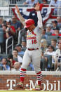 St. Louis Cardinals' Kolten Wong celebrates after scoring on a wild pitch by Atlanta Braves pitcher Max Fried during the first inning of Game 5 of their National League Division Series baseball game Wednesday, Oct. 9, 2019, in Atlanta. (AP Photo/John Bazemore)