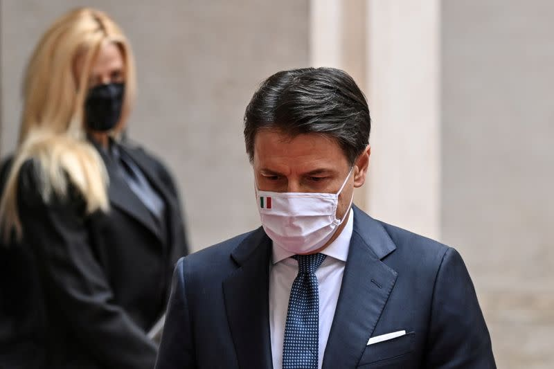 FILE PHOTO: Italy's outgoing Prime Minister, Giuseppe Conte walks past his companion Olivia Paladino as he leaves following a formal handover ceremony with incoming Prime Minister Mario Draghi at Palazzo Chigi in Rome