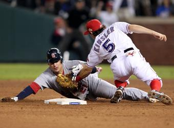 Texas second baseman Ian Kinsler tags out Allen Craig at second base to complete a double play in the ninth inning of Game 5