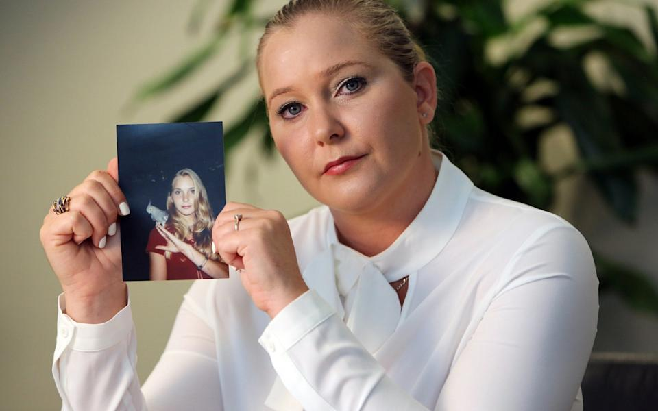 Virginia Roberts holds a photo of herself at age 16, when she says Palm Beach multimillionaire Jeffrey Epstein began abusing her sexually. - Getty