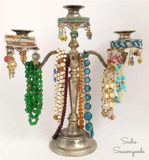 "<p>If you're not hosting into lavish formal banquets, convert that silver candelabra into a more useful jewelry tree. Drape necklaces over the arms, stack bracelets over the candleholders, and punch holes in the bobeches to hold pierced earrings. Simple and prettier than a tangled mess of jewelry on your dresser!</p><p><br></p><p><strong>See more at <a href=""http://www.sadieseasongoods.com/thrifty-ritzy-a-candelabra-jewelry-tree/"" rel=""nofollow noopener"" target=""_blank"" data-ylk=""slk:Sadie Seasongoods"" class=""link rapid-noclick-resp"">Sadie Seasongoods</a>.</strong></p>"