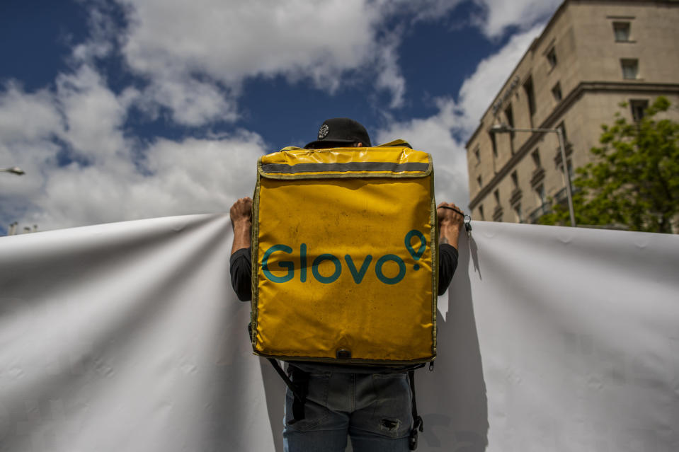 A delivery worker protests in front of the Spanish Parliament in Madrid, Spain, Tuesday, May 11, 2021. Spain has approved a pioneering law that gives delivery platforms a mid-August deadline to hire the workers currently freelancing for them and that requires transparency of artificial intelligence to manage workforces. (AP Photo/Manu Fernandez)