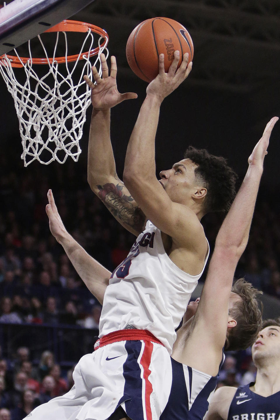 Gonzaga forward Brandon Clarke, left, shoots in front of BYU forward Luke Worthington during the second half of an NCAA college basketball game in Spokane, Wash., Saturday, Feb. 23, 2019. Gonzaga won 102-68. (AP Photo/Young Kwak)