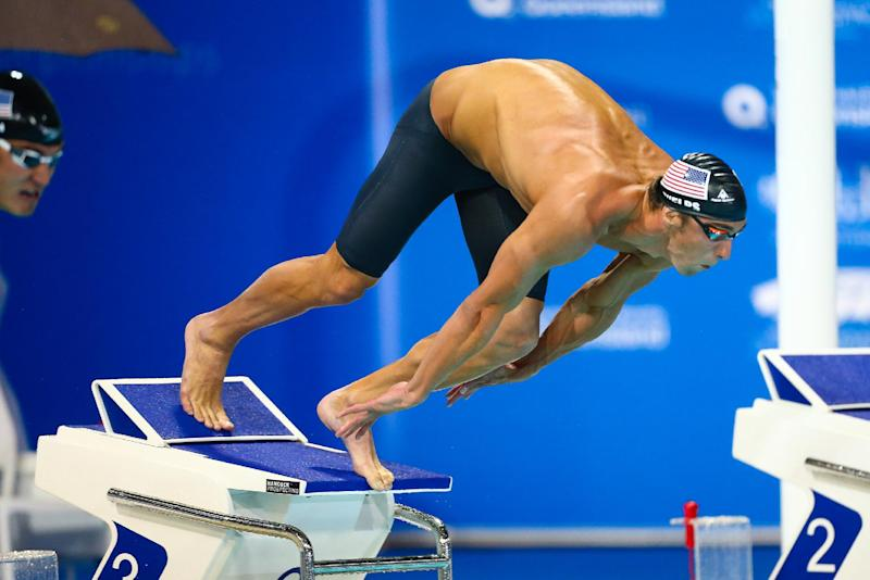 Michael Phelps at the start of the 100m final at the Pan Pacific Championships in Gold Coast on August 22, 2014