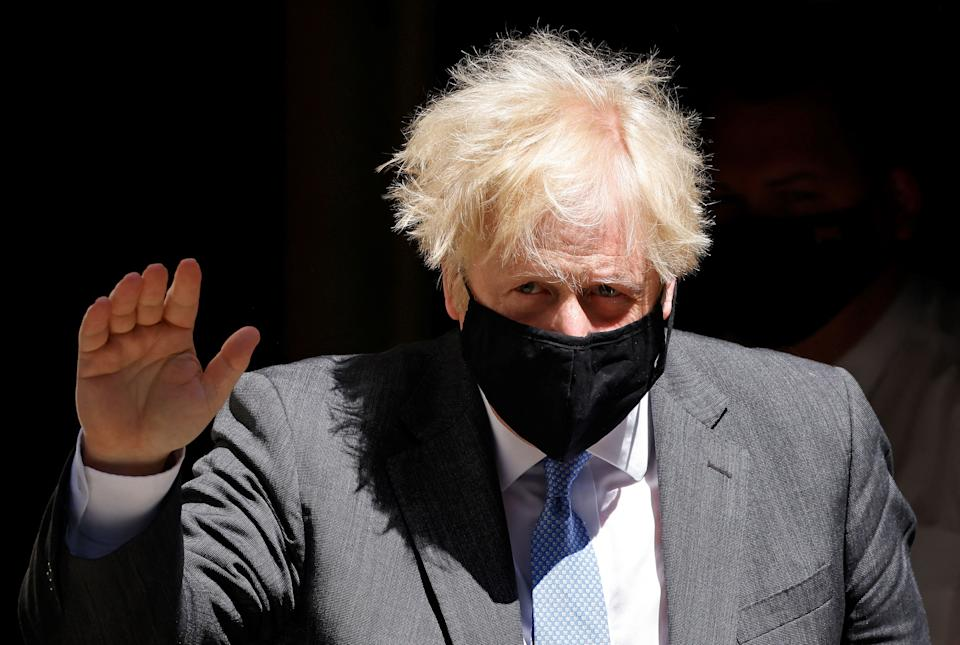 Britain's Prime Minister Boris Johnson, wearing a face mask to combat the spread of Covid-19, leaves 10 Downing Street in central London on June 16, 2021, to take part in the weekly session of Prime Minister's Questions (PMQs) at the House of Commons. (Photo by Tolga Akmen / AFP) (Photo by TOLGA AKMEN/AFP via Getty Images)