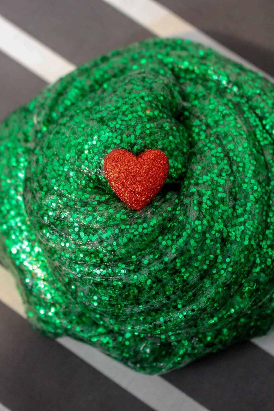 "<p>Slime is popular for its versatility, and the fact that it's extremely fun to play with! That's why your kids will enjoy mixing up a batch of Grinch-inspired slime—with a red heart to boot.</p><p><strong>Get the tutorial at <a href=""https://www.iheartartsncrafts.com/grinch-slime-recipe/"" rel=""nofollow noopener"" target=""_blank"" data-ylk=""slk:I Heart Arts 'n Crafts"" class=""link rapid-noclick-resp"">I Heart Arts 'n Crafts</a>.</strong></p><p><a class=""link rapid-noclick-resp"" href=""https://www.amazon.com/Pacon-Spectra-Sparkling-Crystals-91660/dp/B000J09NQS/ref=sr_1_2_sspa?tag=syn-yahoo-20&ascsubtag=%5Bartid%7C10050.g.5030%5Bsrc%7Cyahoo-us"" rel=""nofollow noopener"" target=""_blank"" data-ylk=""slk:SHOP GREEN GLITTER"">SHOP GREEN GLITTER</a></p>"