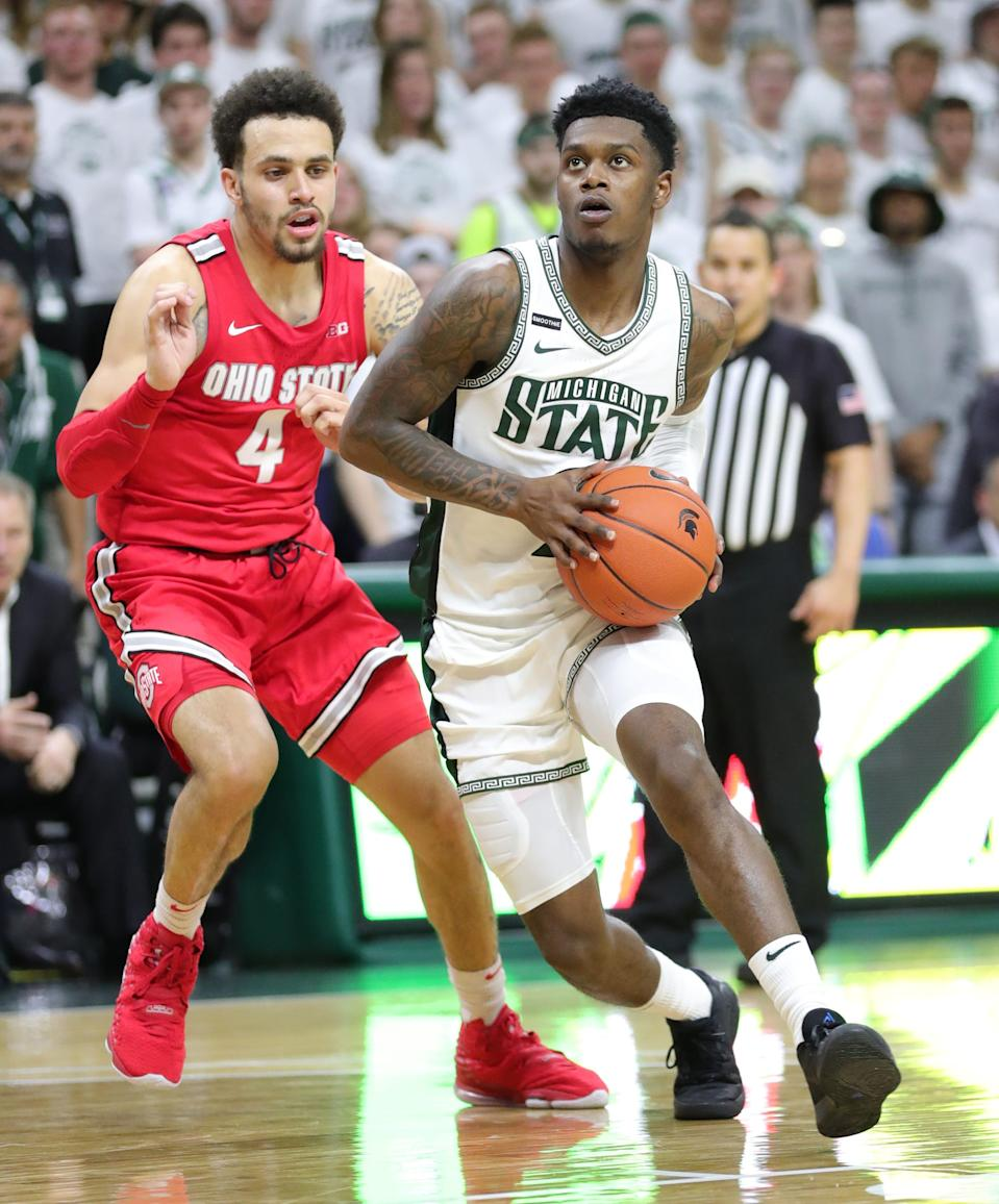 Michigan State's Rocket Watts drives against Ohio State's Duane Washington Jr. during the second half Sunday, March 8, 2020 at the Breslin Center.