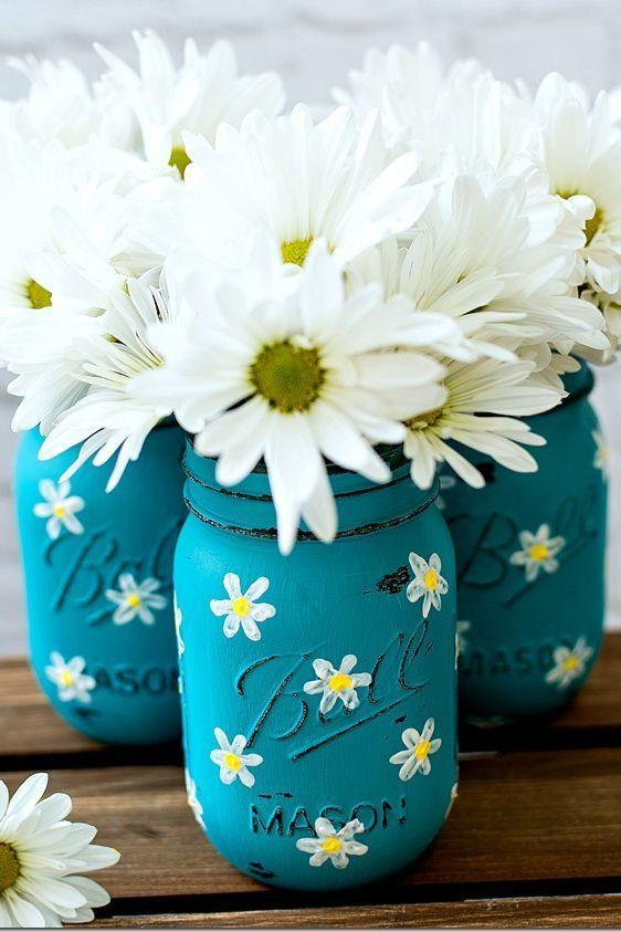 """<p>Use these painted Mason jar vases to decorate the house before Mother's Day. Filled with fresh blooms, they'll give her home a wonderful smell <em>and</em> look.</p><p><strong>Get the tutorial at <a href=""""http://masonjarcraftslove.com/painted-daisy-mason-jars/"""" rel=""""nofollow noopener"""" target=""""_blank"""" data-ylk=""""slk:Mason Jar Crafts"""" class=""""link rapid-noclick-resp"""">Mason Jar Crafts</a>.</strong></p><p><strong><strong><a class=""""link rapid-noclick-resp"""" href=""""https://go.redirectingat.com?id=74968X1596630&url=https%3A%2F%2Fwww.walmart.com%2Fip%2FU-S-Art-Supply-Professional-36-Color-Set-of-Acrylic-Paint-in-Large-18ml-Tubes-Rich-Vivid-Colors-for-Artists-Students%2F877776236&sref=https%3A%2F%2Fwww.thepioneerwoman.com%2Fholidays-celebrations%2Fgifts%2Fg32307619%2Fdiy-gifts-for-mom%2F"""" rel=""""nofollow noopener"""" target=""""_blank"""" data-ylk=""""slk:SHOP ACRYLIC PAINT"""">SHOP ACRYLIC PAINT</a></strong><br></strong></p>"""