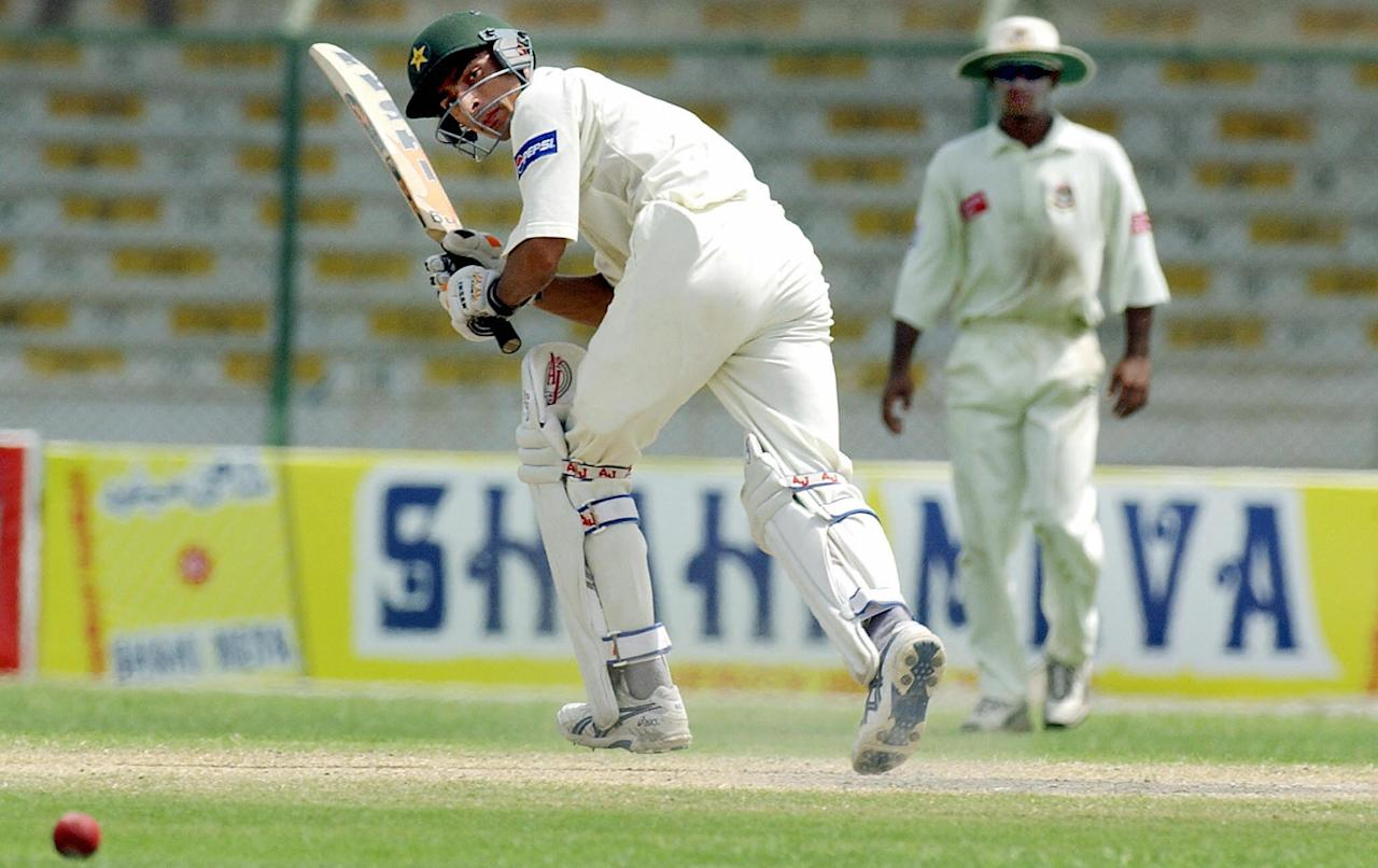 Pakistani batsman Yasir Hameed (L) hits a ball off Bangladeshi bowler Mashrafi-bin-Murtaza (not in the picture) on his way to score a century during the last day of the first Test match between Pakistan and Bangladesh in Karachi, 24 August 2003.  Hameed became only the second batsman in the Test cricket's 128-year history to hit two hundreds in his first Test following West Indian Lawrence Rowe's 214 and 100 not out against New Zealand at Kingston in 1971-72. The twin hundred by debutant Hameed inspired Pakistan to a seven-wicket win over Bangladesh.   AFP PHOTO/Jewel SAMAD  (Photo credit should read JEWEL SAMAD/AFP/Getty Images)