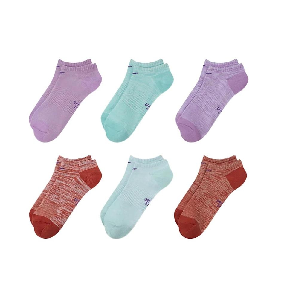 """Come for the cute colors, stay for the moisture-wicking technology. Nike's lightweight, no-show training socks may not be as low-profile as some other options on this list, but they're great for high-intensity workouts since they're made from the brand's signature breathable knit fabric and feature a ribbed cuff at the ankle for zero slippage. $20, Nike. <a href=""""https://www.nike.com/t/everyday-womens-lightweight-no-show-training-socks-6-pairs-0zj6cm/SX7573-970"""" rel=""""nofollow noopener"""" target=""""_blank"""" data-ylk=""""slk:Get it now!"""" class=""""link rapid-noclick-resp"""">Get it now!</a>"""