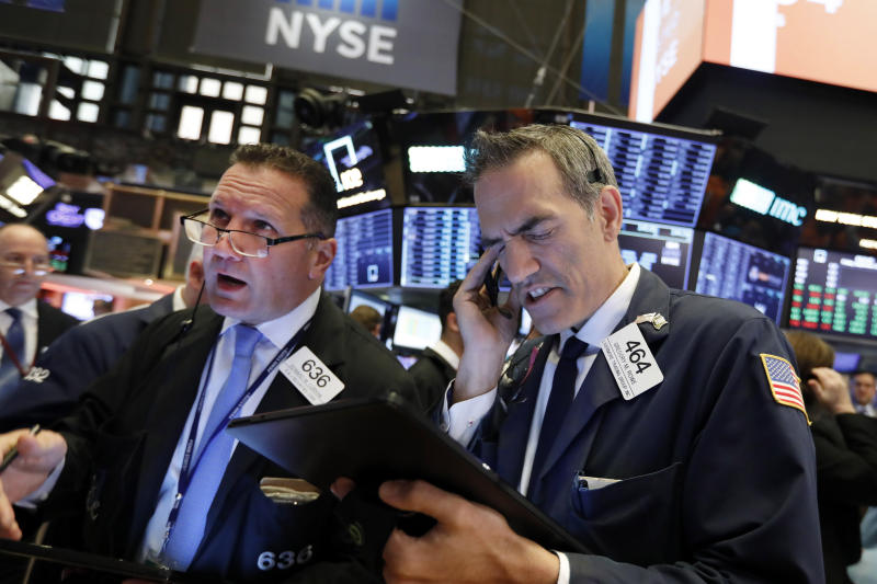 Traders Edward Curran, left, and Gregory Rowe work on the floor of the New York Stock Exchange, Friday, Sept. 13, 2019. Stocks are having a mixed performance early on Wall Street Friday as gains in banks and energy companies are offset somewhat by a drop in technology stocks. (AP Photo/Richard Drew)
