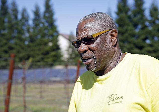 In this March 13, 2014 photo, Dusty Baker stands in his vineyard while talking about his future at his home in Granite Bay, Calif. While his former players and fellow managers are busy preparing for opening day, Baker is busy tending to his crops and minding his vineyard and the several hybrid fruit trees that border it. Out of uniform for the first time since taking 2007 off between managerial jobs with the Cubs and Reds, Baker is not slowing down much from his pressure-packed days in the dugout. (AP Photo/Eric Risberg)