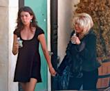 """<p>AJ Lambert walks hand-in-hand with her mother, Nancy Sinatra, as they take a water break on set. Nancy, the daughter of Frank Sinatra, made <a href=""""https://www.youtube.com/watch?v=AQ8e3mO6TVE"""" rel=""""nofollow noopener"""" target=""""_blank"""" data-ylk=""""slk:an appearance as herself"""" class=""""link rapid-noclick-resp"""">an appearance as herself</a> in season 6. </p>"""