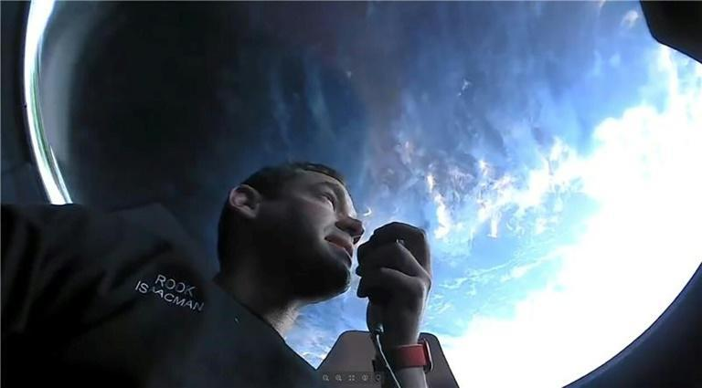 Mission commander Jared Isaacman, an American billionaire, on board SpaceX's Dragon capsule in orbit around the Earth (AFP/Handout)