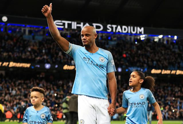 Vincent Kompany gives one last thumbs-up to fans at the Etihad after his goal vs. Leicester City capsized Liverpool's title chances on May 6. (Getty)