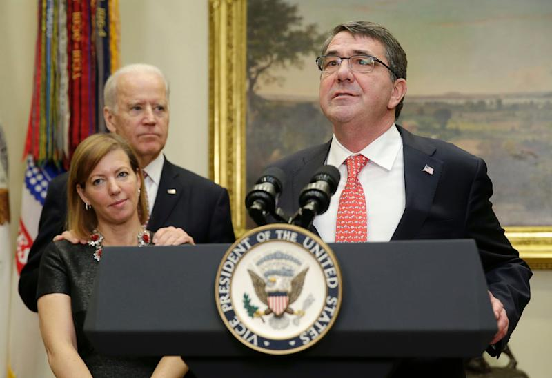 New U.S. Secretary of Defense Ash Carter delivers his acceptance speech at the White House as Vice President Joe Biden and Carter's wife, Stephanie Carter, look on, Feb. 17, 2015. (Photo: Gary Cameron/Reuters/File)