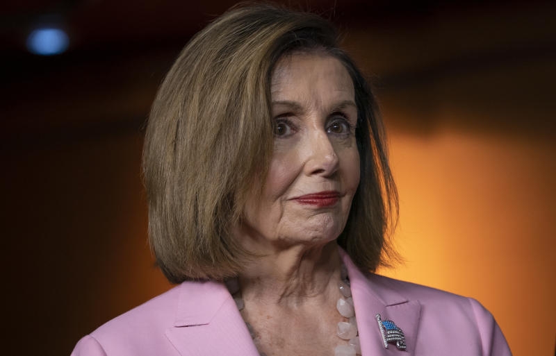 Speaker of the House Nancy Pelosi, D-Calif., leads other House Democrats to discuss H.R. 1, the For the People Act, which passed in the House but is being held up in the Senate, at the Capitol in Washington, Friday, Sept. 27, 2019. (AP Photo/J. Scott Applewhite)
