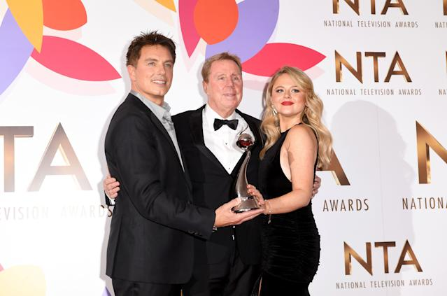 John Barrowman, Harry Redknapp and Emily Atack with The Bruce Forsyth Entertainment Award for I'm A Celebrity… Get Me Out Of Here! during the National Television Awards held at The O2 Arena. (Photo by Stuart C. Wilson/Getty Images)