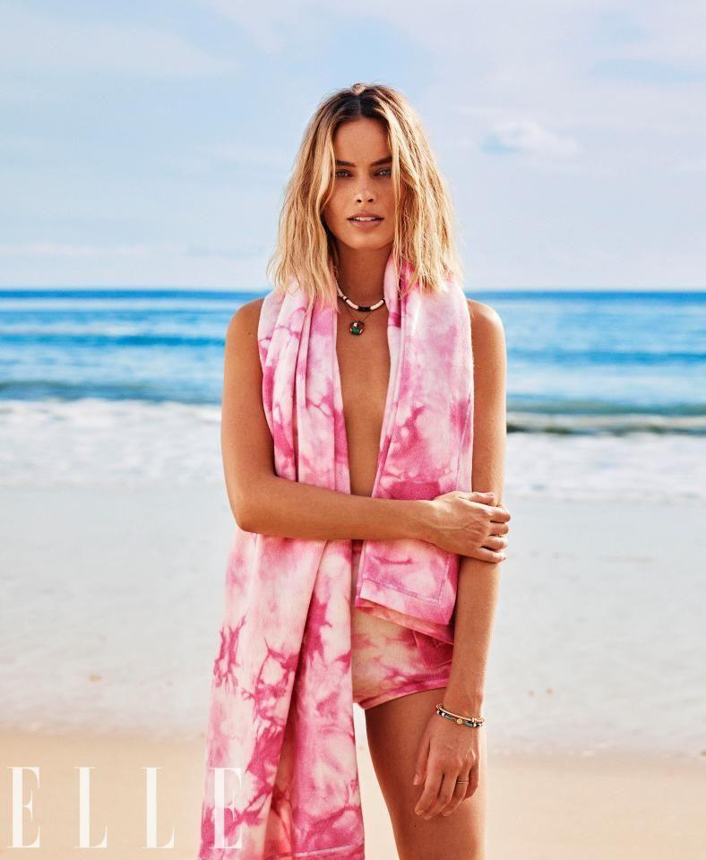 Margot Robbie sizzles in the new cover-shoot fro Elle going topless on the beach. Source: Alex Lubomirski/Elle Magazine