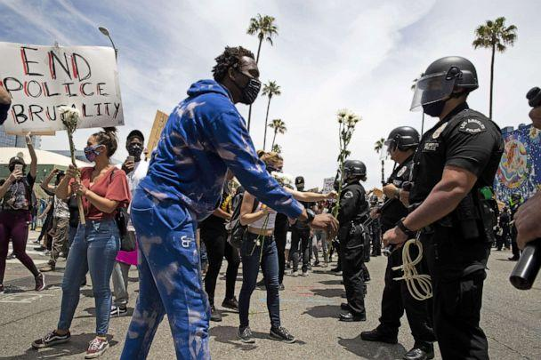 PHOTO: Demonstrators talk to members of the LAPD during a march in response to George Floyd's death on June 2, 2020, in Los Angeles. (Brent Stirton/Getty Images)