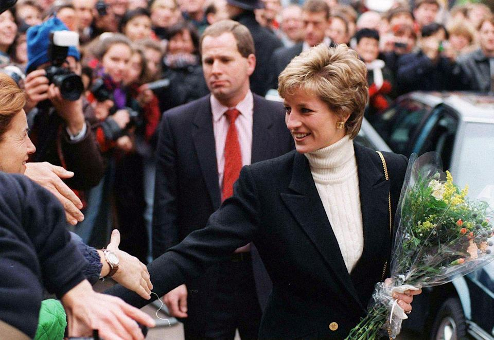 <p>Princess Diana appeared at a charity event in 1995 wearing a cream cable knit turtleneck which she deftly paired with a black blazer on top.</p>