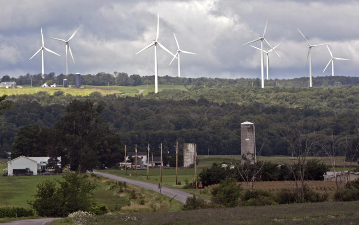 <p> FILE--In this Aug. 4, 2008 file photo, wind turbines from the Maple Ridge Wind Farm tower over farms in Martinsburg, N.Y. A new study says New York could be completely powered by wind, water and sunlight by 2030 with a concerted push, though the state's own decade-long effort to significantly boost green energy shows how difficult that would be in practice. (AP Photo/Mike Groll, File)</p>