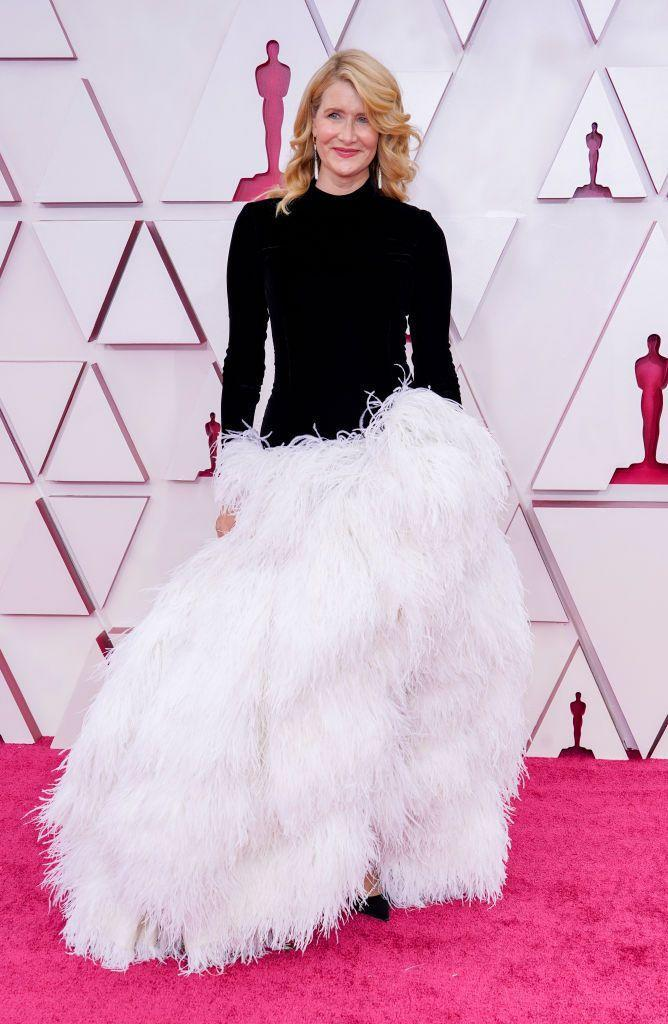 <p>Laura Dern was one of the few actresses to step away from the traditional for the 2021 Oscars, opting for this striking monochrome gown by Oscar de la Renta. The dress was made up of a black sleeved bodice with a dramatic white feathered skirt, which looked sensational as she walked down the red carpet.</p>