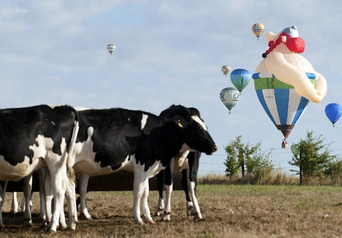 The balloons included some spectacular designs such as a French chateau and rotund cartoon character Obelix (AFP Photo/Jean-Christophe Verhaegen)