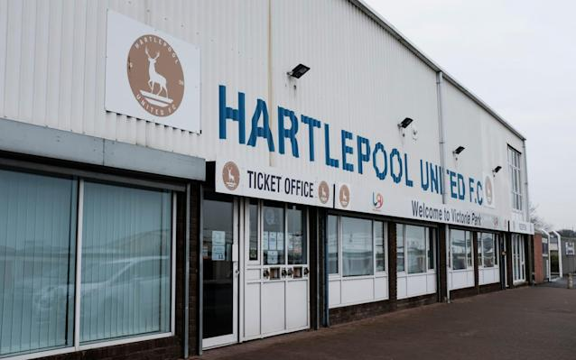 """Hartlepool United are still embroiled in a desperate fight for survival, despite a heroic effort from one of their young supporters, who has raised enough money to pay the club's tax bill. The club have confirmed that a winding up bill issued by HMRC has been withdrawn after their outstanding tax bill was paid off by supporter Rachel Cartwright, who set up a fundraising campaign to save the club. The National League club, which has been put up for sale amid mounting debts, had been issued with a prospective court date as HMRC looked to recover a payment understood to amount to £48,000. That threat has now passed thanks to Cartwright, who set up a Just Giving page as the depth of the club's problems emerged. The fund has received donations from across the country after news of Hartlepool's plight spread last month. However, the troubled North East side remain on the brink of liquidation and there are fears there will not be enough money to pay the wages of players and staff on Feb 25. The club also owe money to several local businesses, including caterers and other suppliers. Hartlepool United's tax bill has been settled but the club is still losing a considerable sum a month and is in desperate need of a takeover Credit: Dave Thompson/PA Wire Should Hartlepool, who arebelieved to be losing as much as £130,000 a month amid escalating debts, fail to pay their staff, they could still be forced out of business. Telegraph Sport understands that there is one interested party currently in the process of due diligence ahead of a possible takeover, but the size of the club's debts, which are already around £2m, have scared everyone else off. Hartlepool United said in a statement: """"We can confirm that Rachel Cartwright, who set up the Just Giving fundraising page for the club, has now paid the outstanding HMRC debt. """"HMRC has confirmed that it will cancel the serving of the winding-up petition and the process to withdraw the winding-up order is under way. """"Once again we would"""
