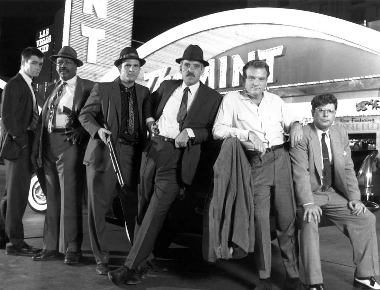 "William Campbell, Paul Butler, Steve Ryan, Dennis Farina, Bill Smitrovich, and Stephen Lang in ""Crime Story."""