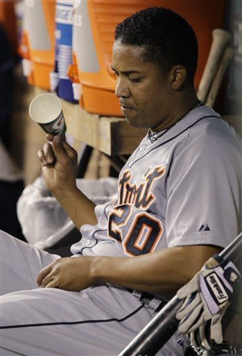 Detroit Tigers pitcher Octavio Dotel tosses a cup in the dugout after he was pulled in the ninth inning of a baseball game against the Seattle Mariners, Monday, May 7, 2012, in Seattle. Dotel was charged with the loss as the Mariners beat the Tigers, 3-2. (AP Photo/Ted S. Warren)