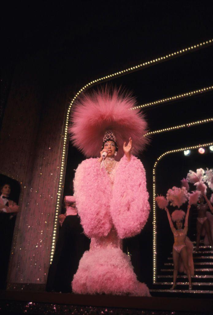 """<p>Josephine Baker went on one final tour in 1975—this time to <a href=""""https://www.biography.com/performer/josephine-baker"""" rel=""""nofollow noopener"""" target=""""_blank"""" data-ylk=""""slk:promote the 50th anniversary of her Paris debut"""" class=""""link rapid-noclick-resp"""">promote the 50th anniversary of her Paris debut</a>. Her first performance on the tour was in Paris's Théâtre Bobino. Sadly, Baker passed away due to a brain hemorrhage days after the show at the age of 68.</p>"""