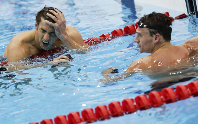 Michael Phelps (L) and Ryan Lochte of the U.S. react after their men's 200m individual medley semi-final during the London 2012 Olympic Games at the Aquatics Centre August 1, 2012. REUTERS/Tim Wimborne (BRITAIN - Tags: SPORT SWIMMING OLYMPICS TPX IMAGES OF THE DAY)
