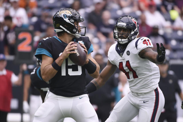 Jacksonville Jaguars quarterback Gardner Minshew (15) is pressured by Houston Texans inside linebacker Zach Cunningham (41) during the first half of an NFL football game Sunday, Sept. 15, 2019, in Houston. (AP Photo/Eric Christian Smith)