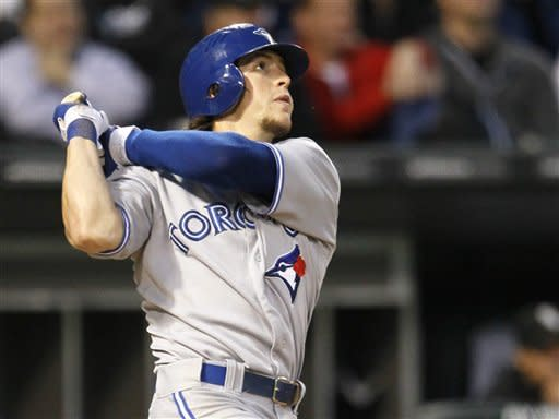 Toronto Blue Jays' Colby Rasmus watches his two-run home run off Chicago White Sox starting pitcher Philip Humber during the fifth inning of a baseball game, Tuesday, June 5, 2012, in Chicago. (AP Photo/Charles Rex Arbogast)