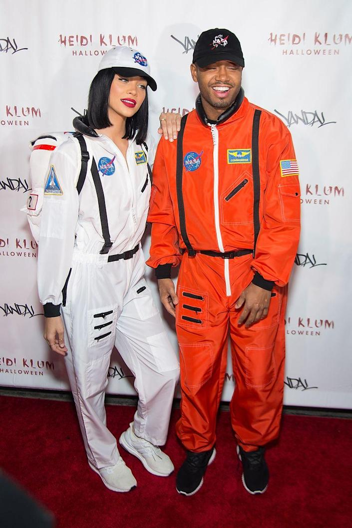"""<p>For a look that's totally out of this world, you and your other half can become astronauts with matching NASA jumpsuits.</p><p><a class=""""link rapid-noclick-resp"""" href=""""https://www.amazon.com/Famajia-Astronaut-Spacewoman-Jumpsuit-Costumes/dp/B07V4C234T?tag=syn-yahoo-20&ascsubtag=%5Bartid%7C10070.g.1923%5Bsrc%7Cyahoo-us"""" rel=""""nofollow noopener"""" target=""""_blank"""" data-ylk=""""slk:SHOP WHITE JUMPSUIT"""">SHOP WHITE JUMPSUIT</a></p><p><a class=""""link rapid-noclick-resp"""" href=""""https://www.amazon.com/Famajia-Astronaut-Spaceman-Prisoner-Halloween/dp/B07QQBYPL5?tag=syn-yahoo-20&ascsubtag=%5Bartid%7C10070.g.1923%5Bsrc%7Cyahoo-us"""" rel=""""nofollow noopener"""" target=""""_blank"""" data-ylk=""""slk:SHOP ORANGE JUMPSUIT"""">SHOP ORANGE JUMPSUIT</a></p>"""