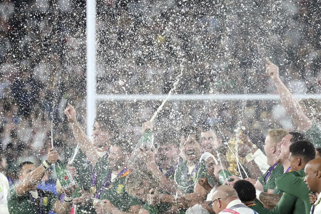 South Africa players, with the Webb Ellis Cup, celebrate after South Africa defeated England to win the Rugby World Cup final at International Yokohama Stadium in Yokohama, Japan, Saturday, Nov. 2, 2019. (AP Photo/Eugene Hoshiko)